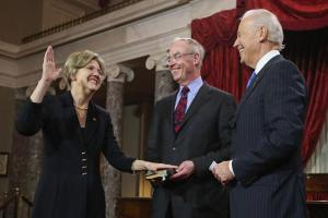 Elizabeth Warren being sworn in by Vice President Joe Biden
