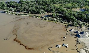 Oil swirls in the Yellowstone river after an Exxon Mobil pipeline ruptured near Billings, Montana.