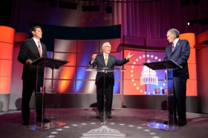 This photo provided by WGBH shows U.S. Senate candidates, Republican Gabriel Gomez, left, and Democratic U.S. Rep. Edward Markey, right before a debate moderated by R.D. Sahl, center, Tuesday at WGBH studios in Boston. (THE ASSOCIATED PRESS)
