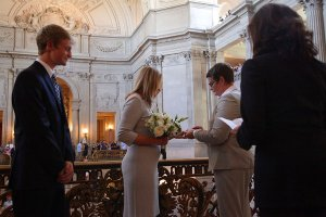 Kris Perry and Sandy Stier, who have been together for more than 15 years and have four sons, were married at San Francisco City Hall by Attorney General Kamala Harris on Friday.