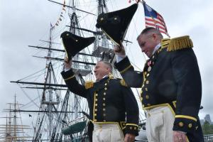 Commander Sean D. Kearns (left) and the USS Constitution's outgoing commanding officer, Matthew J. Bonner, saluted attendees after Kearns officially took over as the ship's new leader.