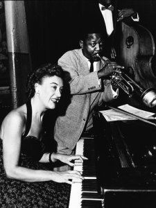 Marian McPartland, who became an articulate spokeswoman for jazz, and the jazz trumpeter Roy Eldridge around the 1950s.