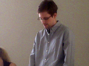Edward Snowden, the NSA leaker seen here in a photo taken in July, has been granted temporary asylum in Russia. Thursday, he left Moscow's airport for the first time in more than a month.