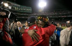 Bib Papi hugs manger John Farrell