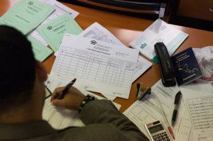S. M. Nural Kabir fills out papers for borrowers, many of whom lack access to credit