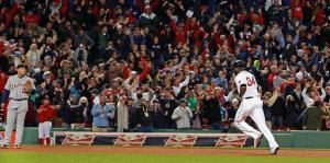 A hero of postseasons past, David Ortiz rounds third base — as the Tigers' Miguel Cabrera looks on — to a standing ovation after his grand slam in the eighth inning tied Game 2 at 5.