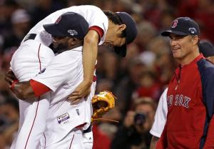 Koji Uehara gets a lift from David Ortiz after the Red Sox closer finished off Tampa Bay with just 11 pitches.  Notice the little smile on John Farrell.