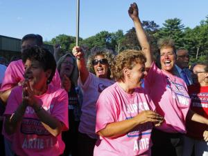 Market Basket employees celebrate the return of Arthur T.