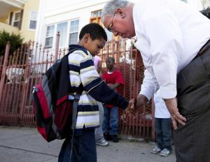 Menino spoke with Edrei Olivero, 7, of Mattapan, before a neighborhood walk in 2010. (Yoon S. Byun/Globe Staff)