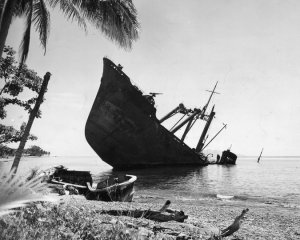 A Japanese vessel was partly submerged off Guadalcanal in 1942 after being hit by American forces. The battle helped turn the Pacific war in favor of the United States and its allies. Some 7,000 Japanese were reported missing on Guadalcanal
