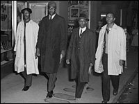 David Richmond (from left), Franklin McCain, Ezell Blair Jr., and Joseph McNeil leave the Woolworth in Greensboro, N.C., where they initiated a lunch-counter sit-in to protest segregation, Feb. 1, 1960. (No photographers were allowed into the store on the first day of protest.)