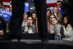Women listening to Hillary Clinton at a campaign event in New Hampshire