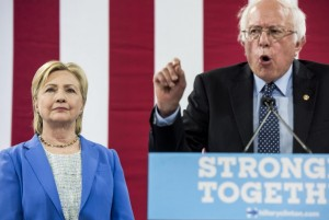 Bernie Sanders speaks near Hillary Clinton